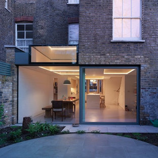 Inspiration for a medium sized modern brick terraced house in London.