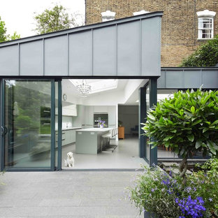 Design ideas for a gey contemporary exterior in London with metal cladding and a lean-to roof.