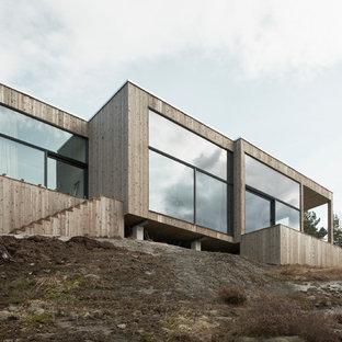 Huge scandinavian beige two-story wood flat roof idea in Stockholm