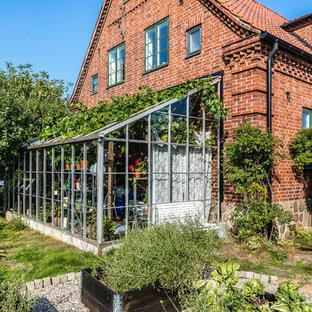 Elegant orange brick exterior home photo in Stockholm