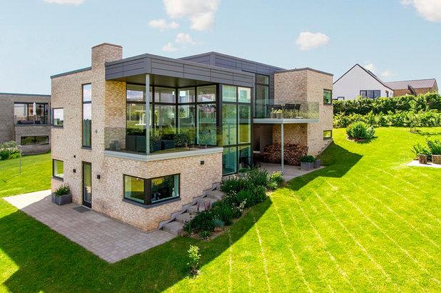 Trendy Hus & facade by Arkitektfirmaet 3D-Form