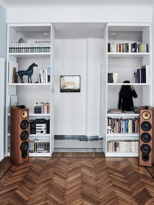 Foto e idee per ingressi ingresso con pavimento in legno for Libreria divisoria con porta