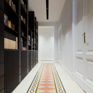 Hallway - contemporary multicolored floor hallway idea in Rome with white walls