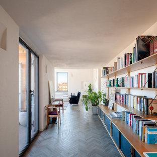 Attico a Trastevere - Ingresso con libreria a parete custom made