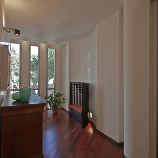 Example of a mid-sized trendy dark wood floor double front door design in Rome with white walls and a white front door