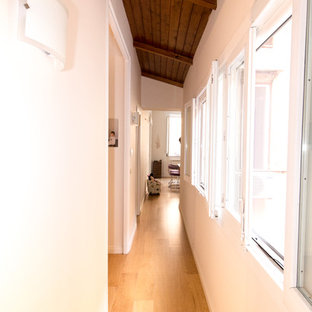 Design ideas for a small midcentury hallway in Catania-Palermo with white walls, light hardwood floors and beige floor.
