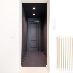カターニア/パルレモのおしゃれな玄関ラウンジ (グレーの壁、コンクリートの床、グレーの床、折り上げ天井) の写真