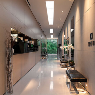 Example of a trendy white floor hallway design in Los Angeles with gray walls