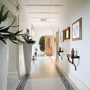 Example of a mid-sized trendy terrazzo floor entryway design in Bologna with white walls and a white front door