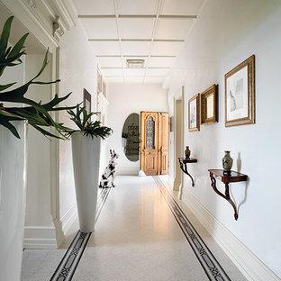 Immagine di un ingresso design di medie dimensioni con pareti bianche, pavimento alla veneziana, una porta a due ante e una porta bianca