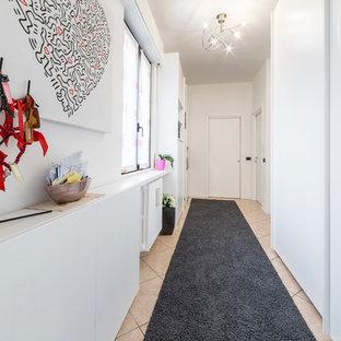Hallway - large contemporary ceramic floor hallway idea in Milan with white walls