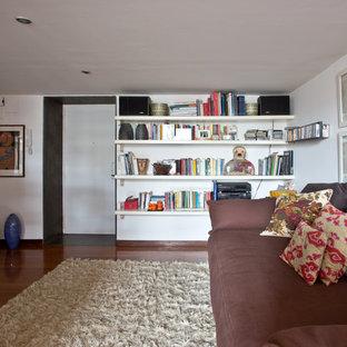 Inspiration for a huge eclectic dark wood floor and brown floor single front door remodel in Naples with white walls and a white front door