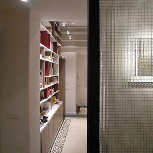 Large trendy terrazzo floor and black floor hallway photo in Rome with white walls