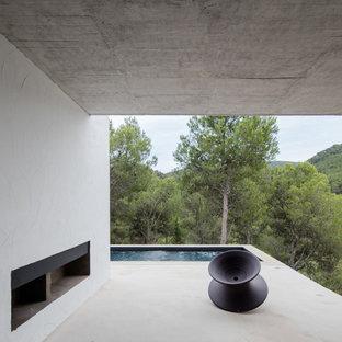 Hanggarten mit Auffahrt und Kamin in Valencia