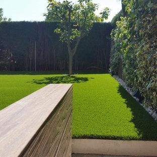 Imagen de jardín minimalista, de tamaño medio, con mantillo