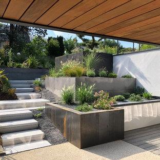 Jardin contemporain avec un mur de soutènement : Photos et idées ...