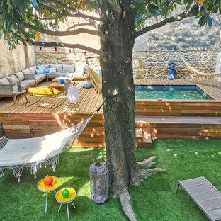Inspiration pour un jardin design l'été avec un bassin et une exposition ensoleillée.