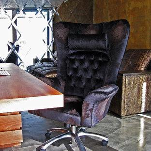 Foto di uno studio contemporaneo di medie dimensioni con pavimento in cemento e scrivania autoportante