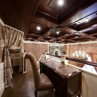 Idée de décoration pour un petit bureau urbain avec un sol en bois foncé, une cheminée standard, un manteau de cheminée en métal et un bureau indépendant.