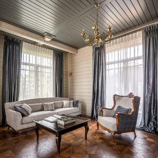 На фото: большой кабинет в стиле современная классика с паркетным полом среднего тона, коричневым полом и белыми стенами с