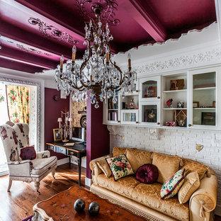 Design ideas for a bohemian study in Saint Petersburg with purple walls, medium hardwood flooring, a freestanding desk and brown floors.