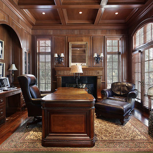 Study room - traditional freestanding desk dark wood floor study room idea in Other with brown walls, a standard fireplace and a tile fireplace