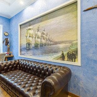 Esempio di un ufficio con pareti blu, pavimento con piastrelle in ceramica, nessun camino, scrivania incassata e pavimento marrone