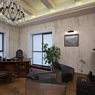 Aménagement d'un bureau industriel avec un mur rouge, un sol en bois brun, une cheminée standard, un manteau de cheminée en métal, un bureau indépendant et un sol marron.