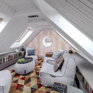 Стильный дизайн: домашняя библиотека среднего размера в современном стиле с белыми стенами и ковровым покрытием без камина - последний тренд