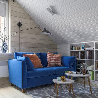 サンクトペテルブルクの中サイズの北欧スタイルのおしゃれなホームオフィス・書斎 (ライブラリー、ラミネートの床) の写真