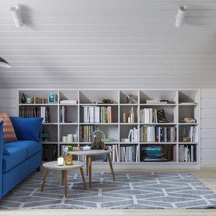 サンクトペテルブルクの中くらいの北欧スタイルのおしゃれなホームオフィス・書斎 (ライブラリー、ラミネートの床) の写真