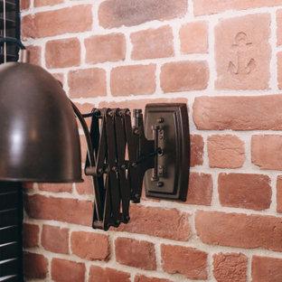 Foto de despacho ladrillo, industrial, pequeño, ladrillo, con suelo de baldosas de terracota, escritorio independiente, suelo marrón, ladrillo y paredes marrones