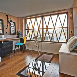 Study room - contemporary freestanding desk medium tone wood floor and orange floor study room idea in Moscow with beige walls