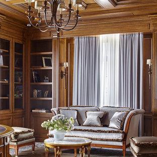 Пример оригинального дизайна: кабинет в классическом стиле с библиотекой, ковровым покрытием и серым полом