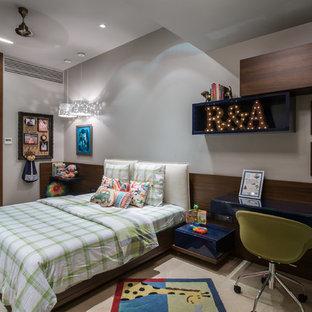 Inspiration pour une chambre d'enfant design avec un mur gris et un sol blanc.