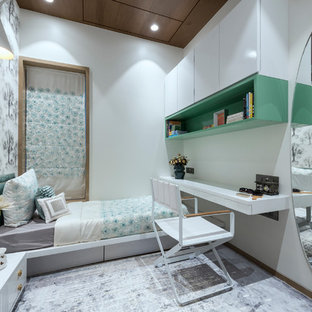 Design ideas for a contemporary kids' bedroom for girls in Mumbai with white walls, carpet and grey floor.