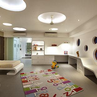 Idées déco pour une chambre d'enfant de 1 à 3 ans contemporaine avec un mur blanc et un sol gris.