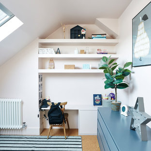 Inspiration for a scandinavian kids' bedroom for girls in London with pink walls.
