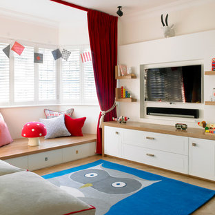 Inspiration for a medium sized traditional kids' room in London with white walls and light hardwood flooring.