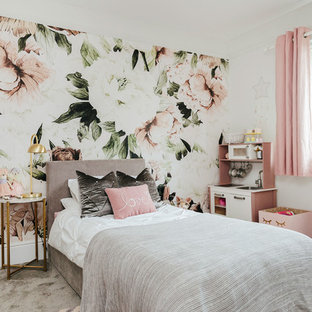 Design ideas for a romantic children's room for girls in London with multi-coloured walls, carpet and grey floors.