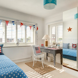 Inspiration for a small coastal kids' room in Devon with white walls and carpet.