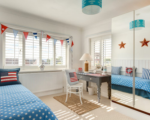 Example Of A Small Coastal Carpeted Kidsu0027 Room Design In Devon With White  Walls
