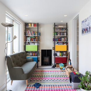 This is an example of a classic kids' bedroom in London with white walls and white floors.