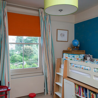 Photo of a classic gender neutral toddler's room in London with multi-coloured walls.