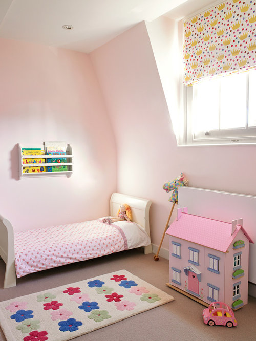 Example Of A Trendy Girl Carpeted Kidsu0027 Bedroom Design In London With Pink  Walls