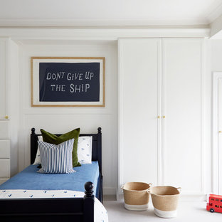 Inspiration for a classic children's room for boys in London with white walls, carpet and grey floors.
