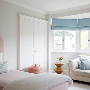 Classic kids' bedroom for girls in London with grey walls.