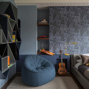 Esempio di una cameretta per bambini da 4 a 10 anni contemporanea con pareti blu