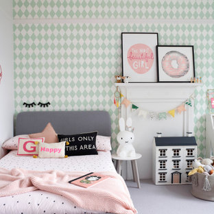 Medium sized contemporary children's room for girls in Buckinghamshire with white walls, grey floors and wallpapered walls.