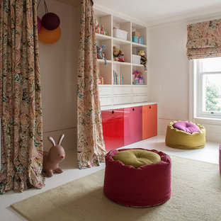 This is an example of a traditional children's room in London with white walls.